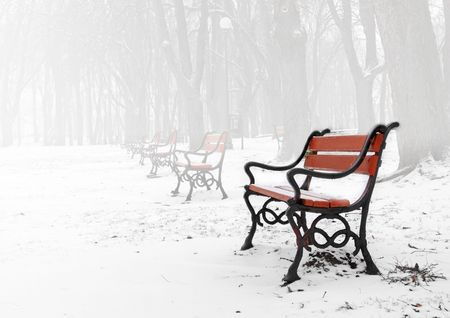snowlandscape: Red bench in the fog in winter