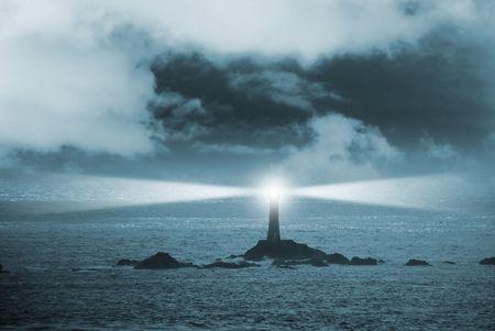 Lighthouse at night Standard-Bild