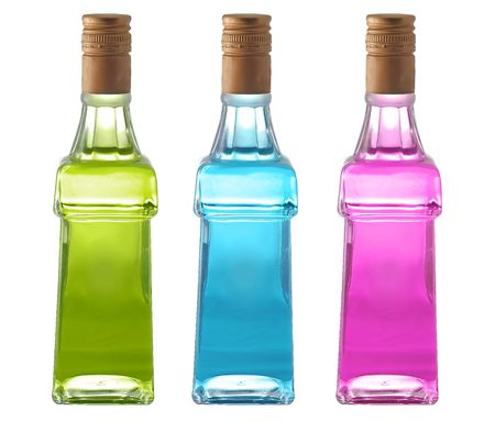 Bottles with colorful liquid isolated on white background Stock Photo - 3731535