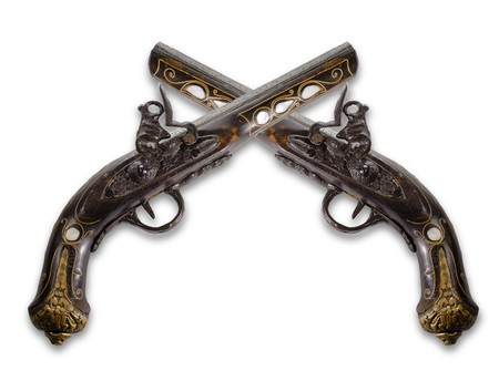 Old flintlock pistols isolated on white background photo