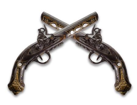Old flintlock pistols isolated on white background photo