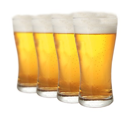 beerhouse: A row of beer pints isolated on white background Stock Photo
