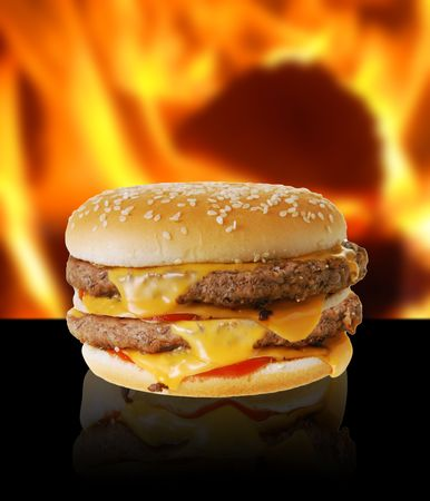 Double cheeseburger on flaming background Stock Photo