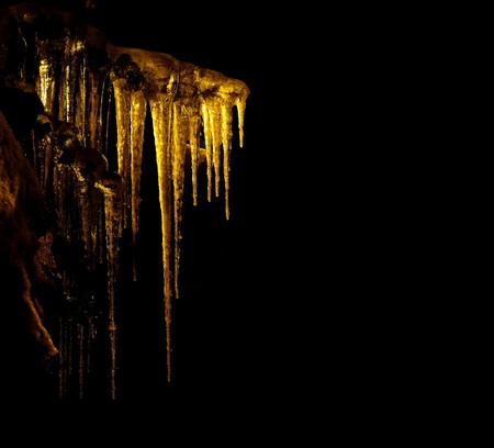 Icicles on black background photo