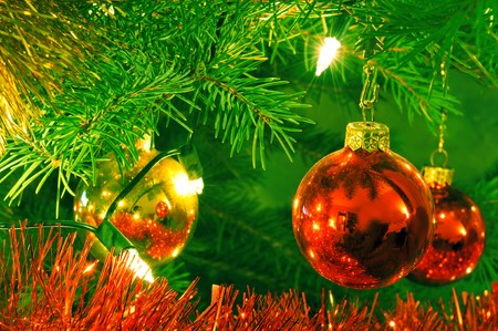 Beautiful christmas baubles hanging on the tree photo