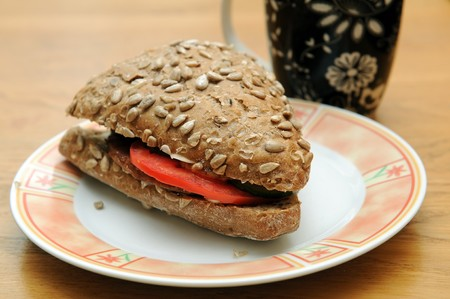 sandwitch: Hamburger and vegetables sandwich on a plate