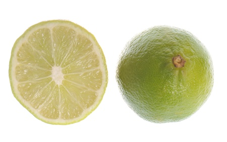 A couple of fresh limes isolated on white background Stock Photo - 8622357