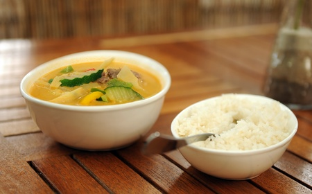 Thai soup with rice in close-up photo