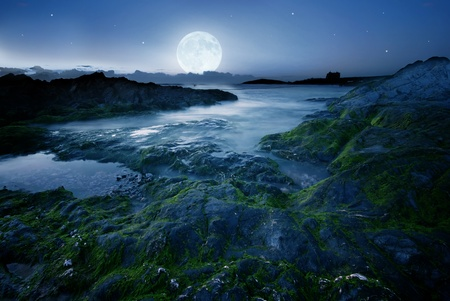 castle rock: Full moon over the coast in Cornwall, UK