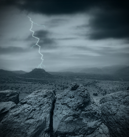 emptiness: Lightning striking a hill in the desert at night Stock Photo