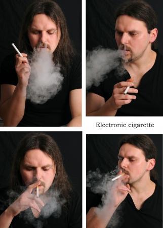 malos habitos: El joven cgarette electr�nico de fumar sobre fondo negro Foto de archivo