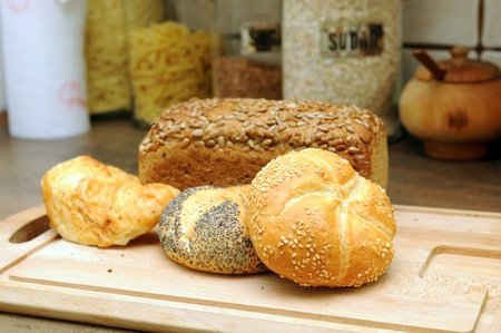 traditional goods: Delicious bread on carving board in the kitchen