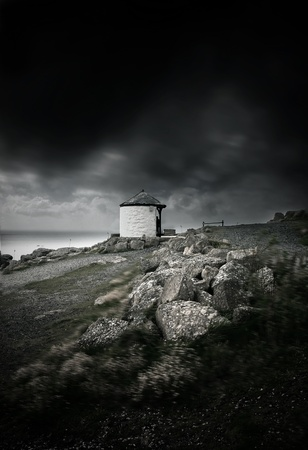 cornwall: Dark stormy clouds and strong wind by the ocean