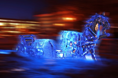 Ice sculpture of a horse and sleigh dashing through a city