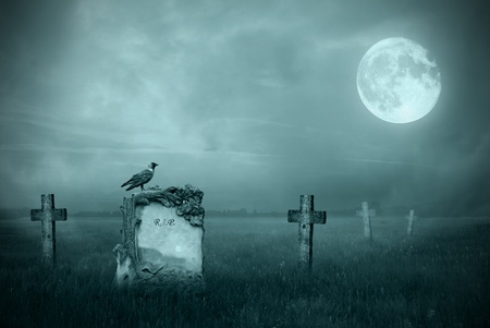 graves: Crow sitting on a gravestone in moonlight Stock Photo
