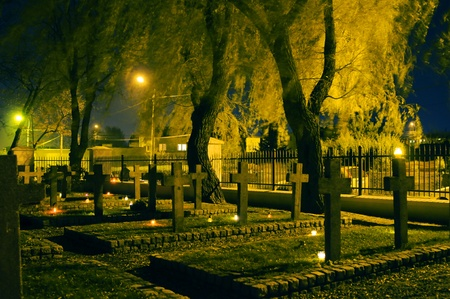 military cemetery: Stone crosses at cemetary at night Stock Photo