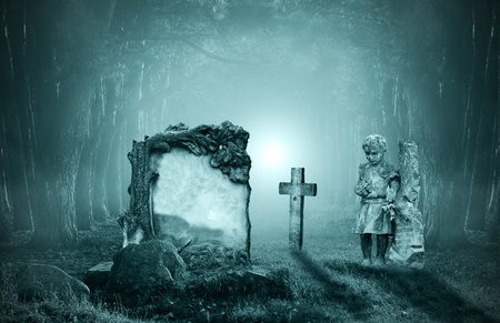 eerie: old graves in a forest at night Stock Photo