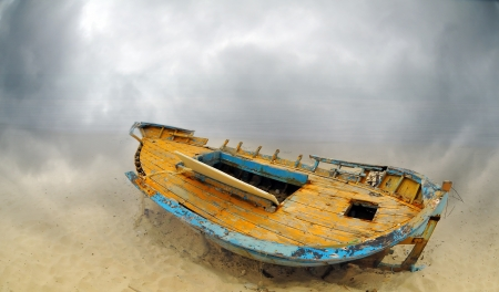 Deserted boat on a beach in Hammamet, Tunisia photo