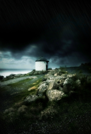 Dark stormy clouds and strong wind by the ocean in Land photo