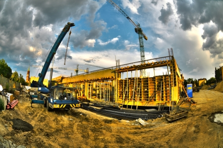 High dynamic range construction site with cranes photo