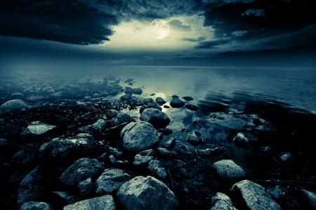 Beautiful full moon reflecting in a lake  Stock Photo