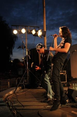 headbanging: SIEDLCE, POLAND - SEPTEMBER 29: Steelfire perform on stage at Rockfest on September 29, 2012 in Siedlce, Poland