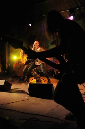 headbanging: SIEDLCE, POLAND - SEPTEMBER 29: Pawel Malaszynski and Cochese perform on stage at Rockfest on September 29, 2012 in Siedlce, Poland  Editorial