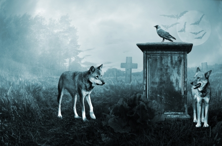 eerie: Wolves guarding an old grave in moonlight Stock Photo