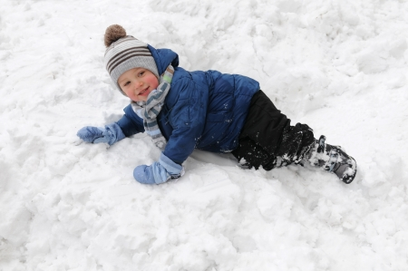 igloo: Cute little boy playing outdoors in the snow