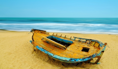Deserted boat on a beach in Hammamet, Tunisia Stock Photo - 17305471