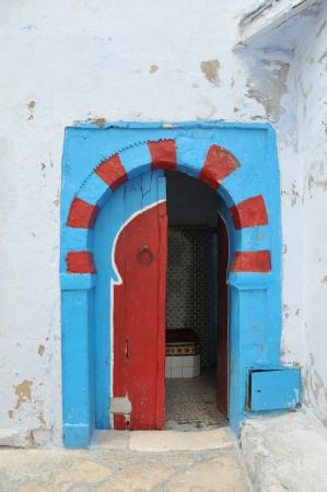 Traditional Tunisian door to a Turkish bath photo