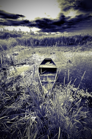 Infrared landscape with boat on a lake photo