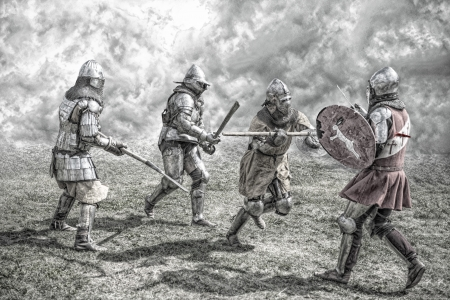 Cavalieri medievali che combattono in una battaglia Archivio Fotografico - 21998106