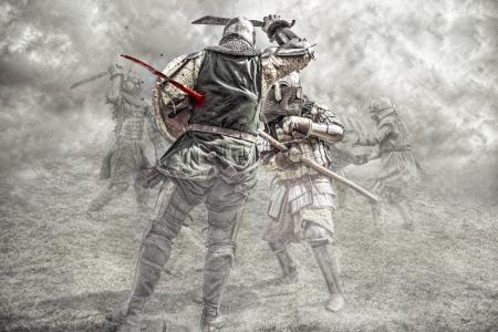 caballero medieval: Caballeros medievales luchando en una batalla Foto de archivo