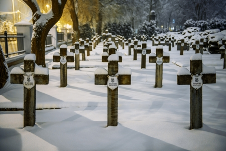 War cemetery in Siedlce, Poland covered with snow at night