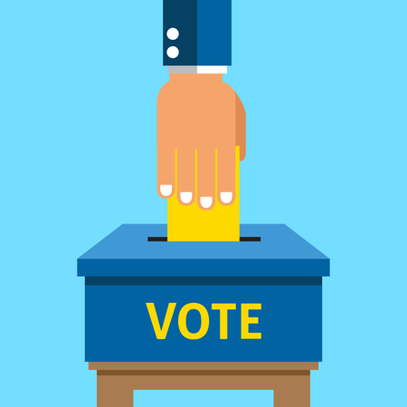 voting: Hand putting voting paper in the ballot box