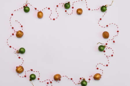 space for an inscription on a white background with snowflakes and christmas balls Banco de Imagens