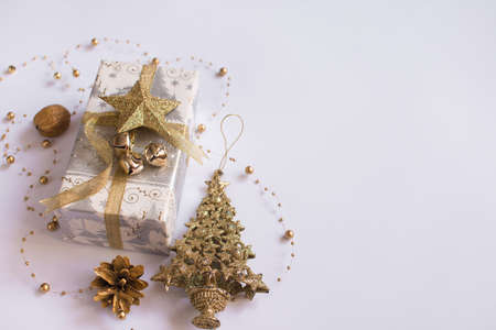 christmas composition. Christmas gift, pine, nut, on a white background. Banco de Imagens