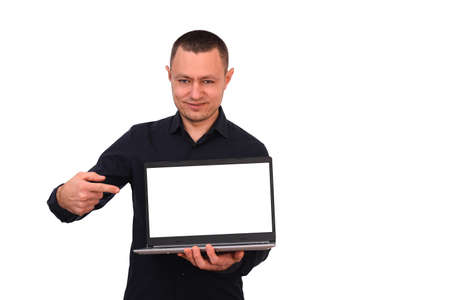 Smiling man pointing his finger at a blank laptop computer screen. isolated on a white background. Banque d'images