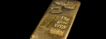 Valcambi Suisse gold bullion bar on black background. Large cast investment gold ingot. Swiss gold. Business and finance.
