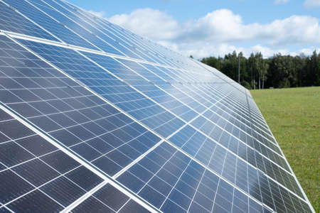 Solar panels. Solar panels on a green grass field