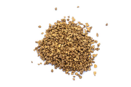 Top view of a pile of small gold particles on pure white background