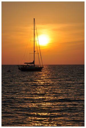Sunset at Nai yang beach Phuket island Thailand photo