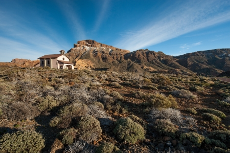 View volcanic desert, church , mountains in the Canary Islands  Stock Photo