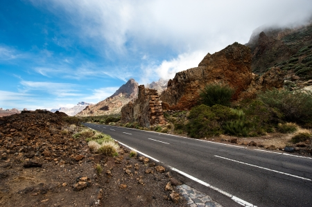 View road in volcanic desert, mountains island of Grand Canary  Stock Photo