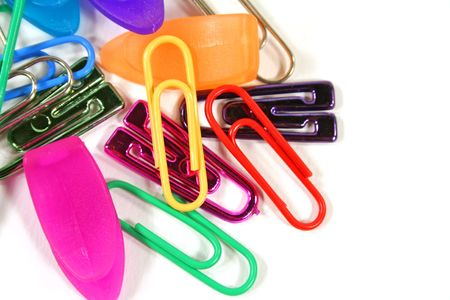 Various types of paper clips isolated on a white background. photo