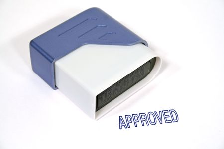 Approved stamp on its side on white background. 版權商用圖片