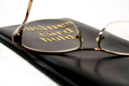 bifocals: Business card holder focussed through glasses. Stock Photo