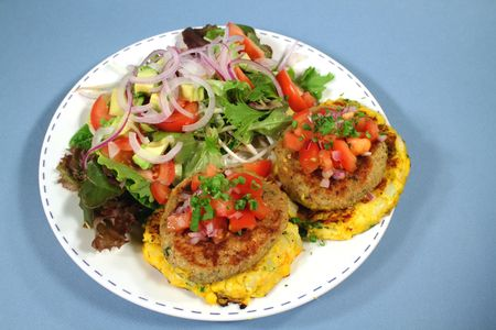 Main of chicken and potato patties with tossed salad. 스톡 콘텐츠