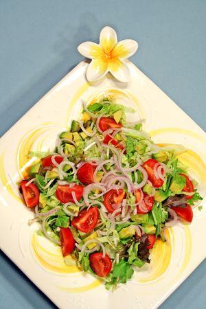 Large tossed salad on a frangipani platter. 스톡 콘텐츠